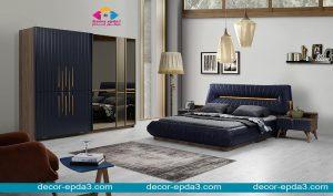 غرفة نوم مودرن باللون الكحلي و سرير و دولاب و كومودينو