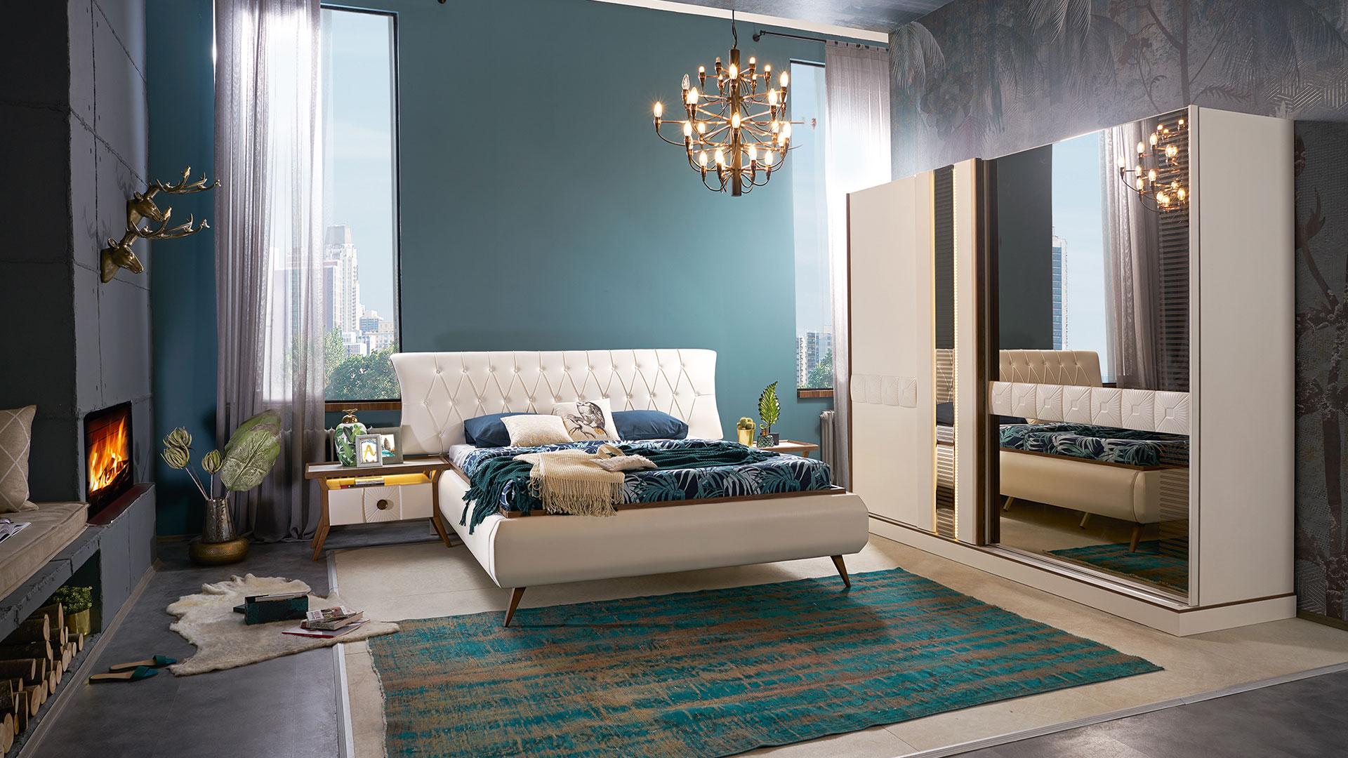 غرفة نوم مودرن باللون الابيض و دولاب و سرير و 2 كومودينو