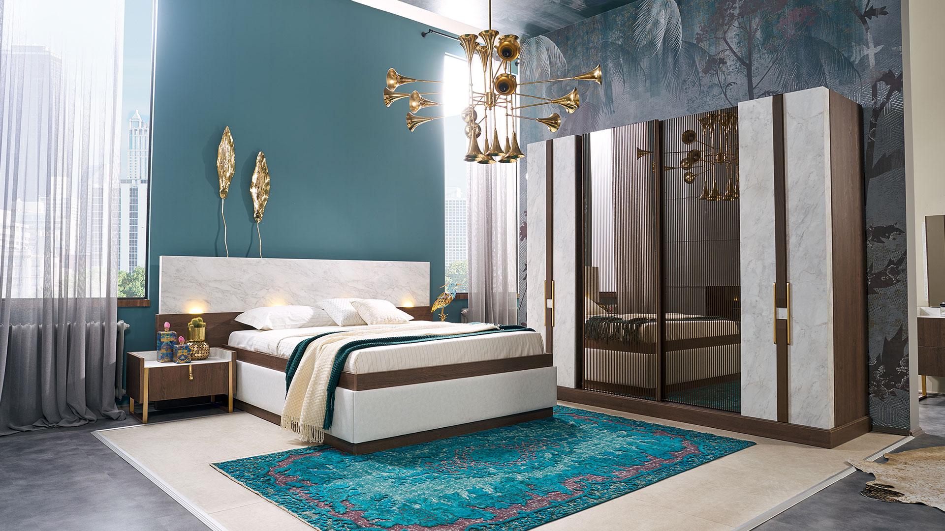 غرفة نوم باللون الابيض و دولاب و سرير