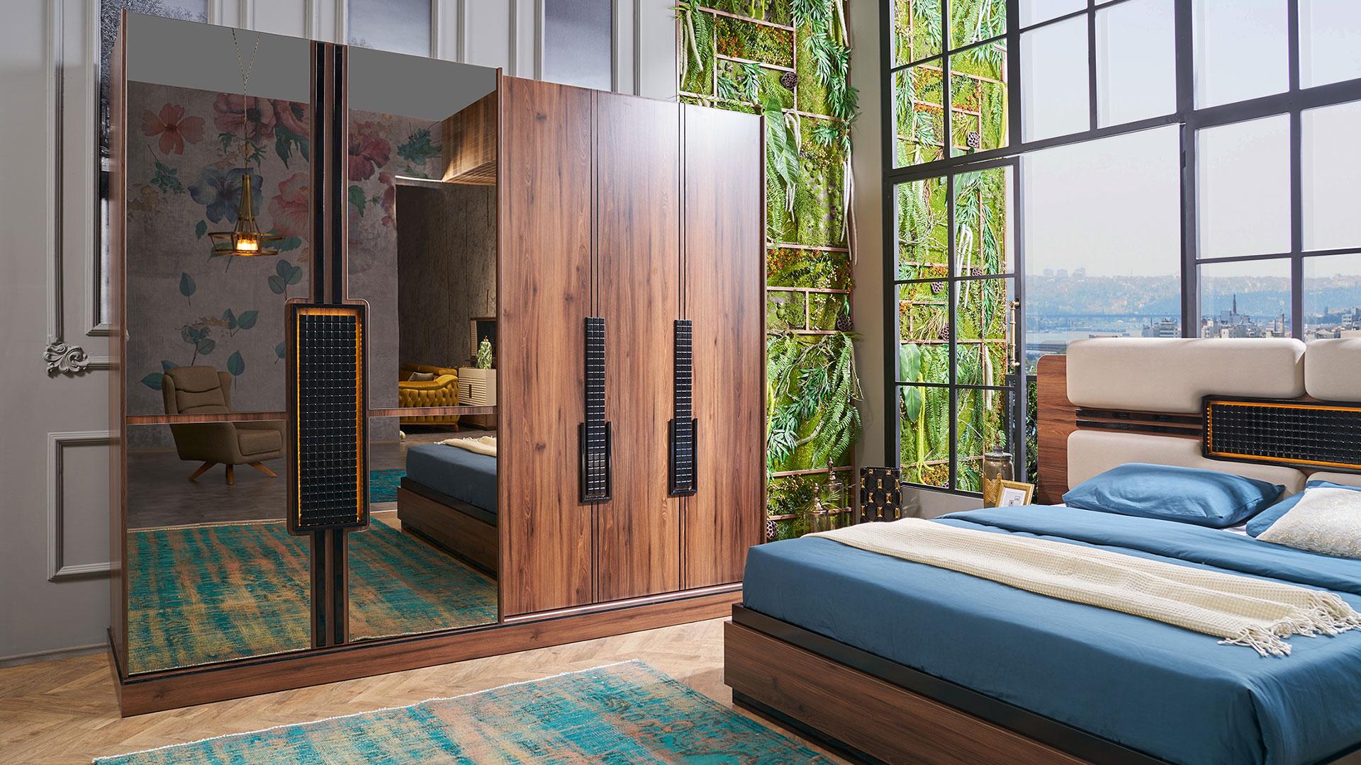 غرفة نوم مودرن باللون الازرق والبني و سرير و دولاب